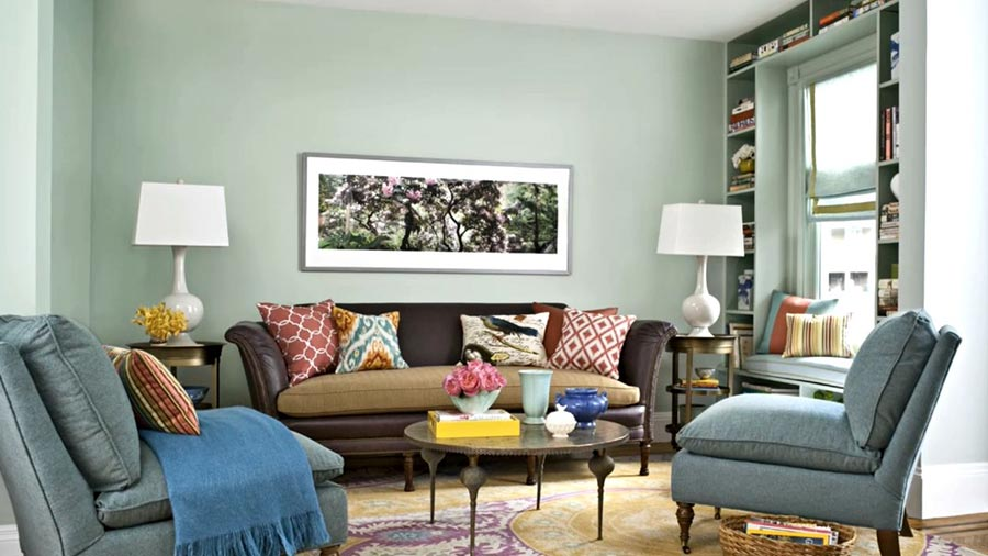 Calm Grey Living Room Paint Colors near Leather Sofa and Grey Sofas facing Round Coffee Table
