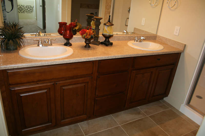 Choose Classic Ornaments to Decorate Oak Bathroom Sink Cabinets with White Sinks and Granite Top