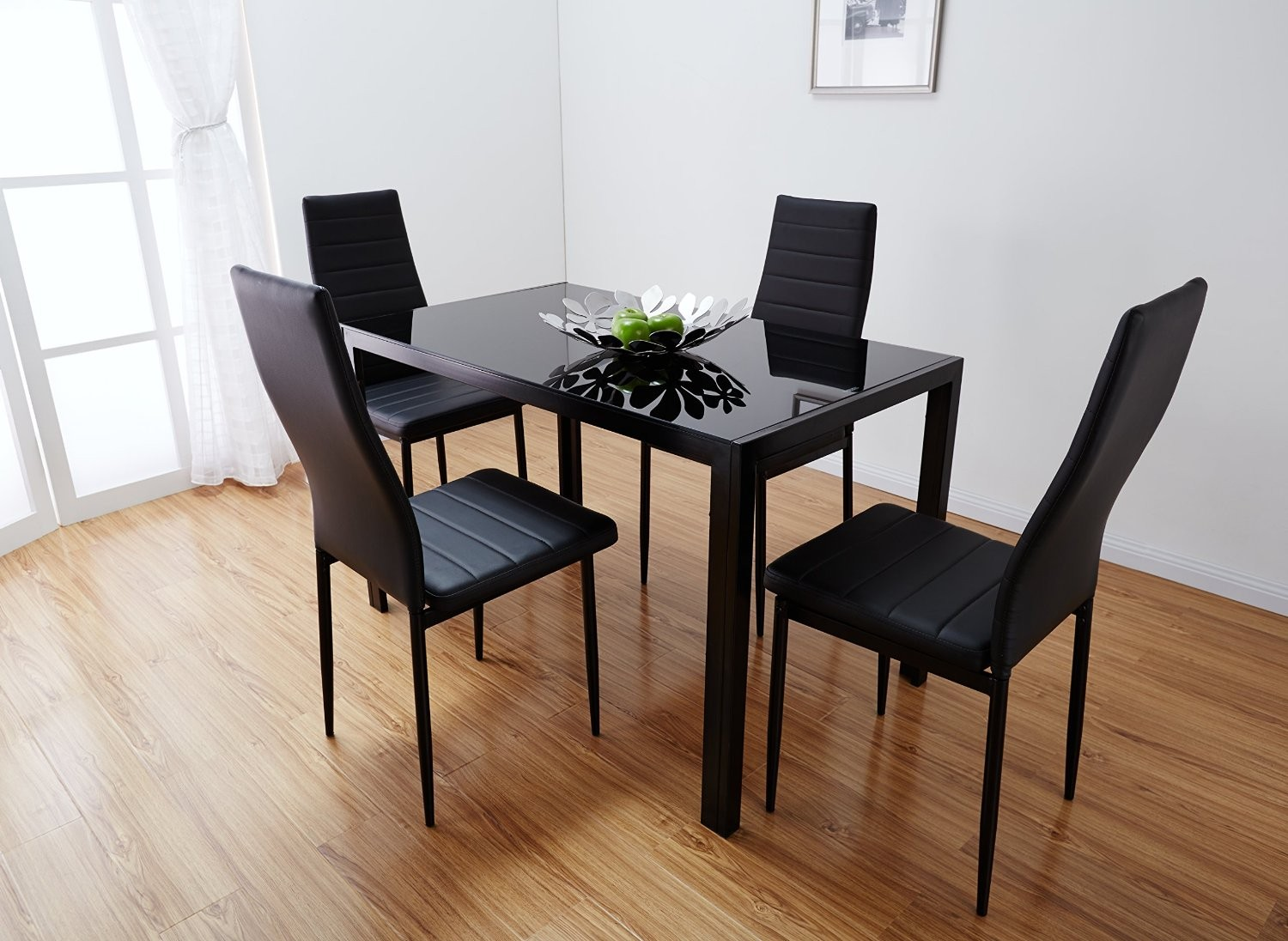 Choose Dark Glass Dining Table Set On Hardwood Flooring For Simple Room  With White Painted Wall