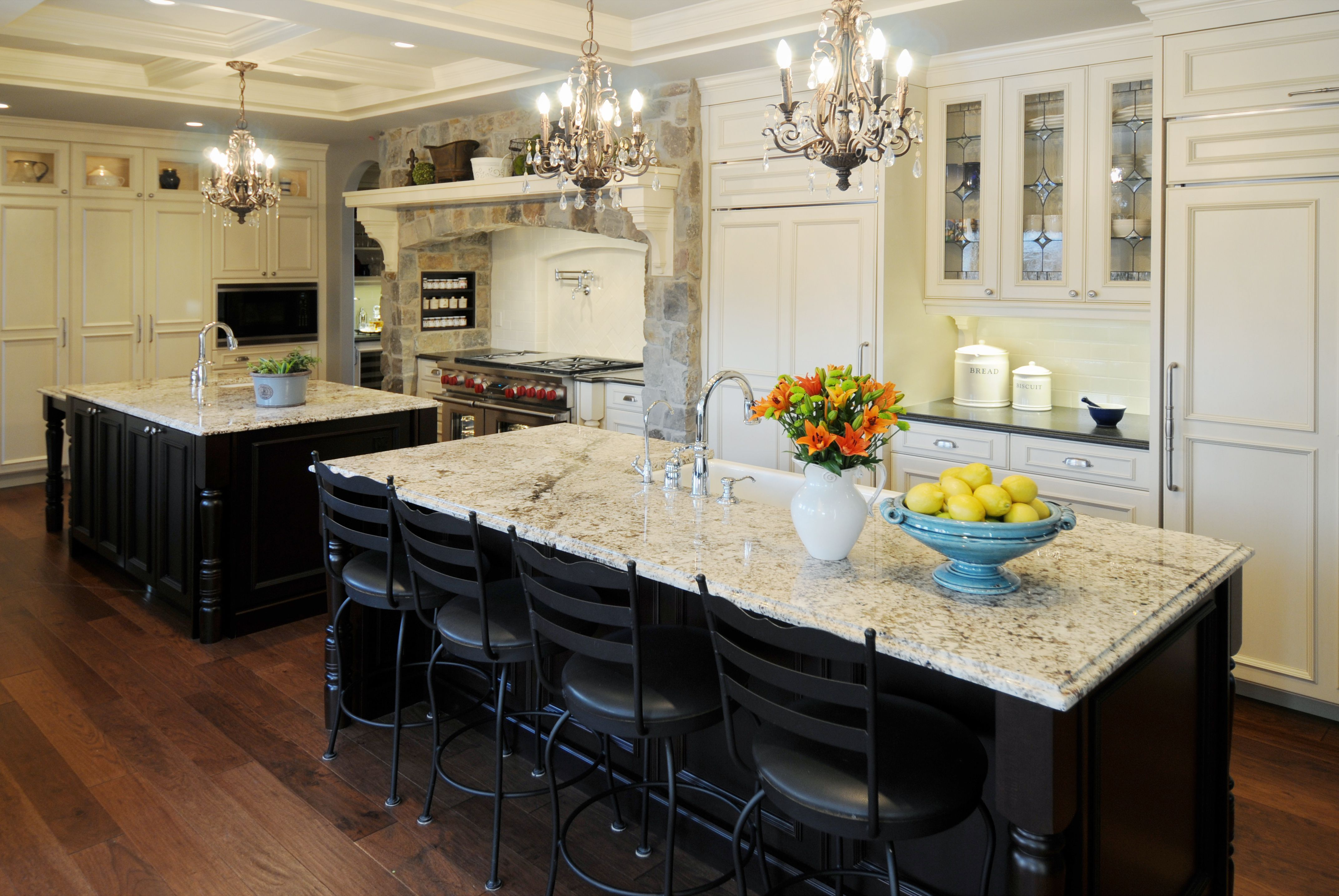 Choose Dark Stools for Classic Kitchen Island Plans under Crystal Chandeliers near White Cabinets