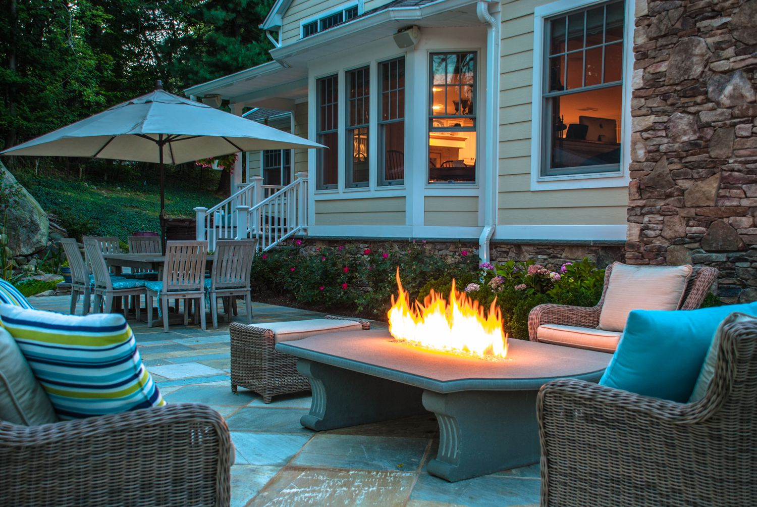 Choose Fabulous Outdoor Fire Pit Ideas For Comfy Patio With Wicker Sofas  And Ottoman Near Wide