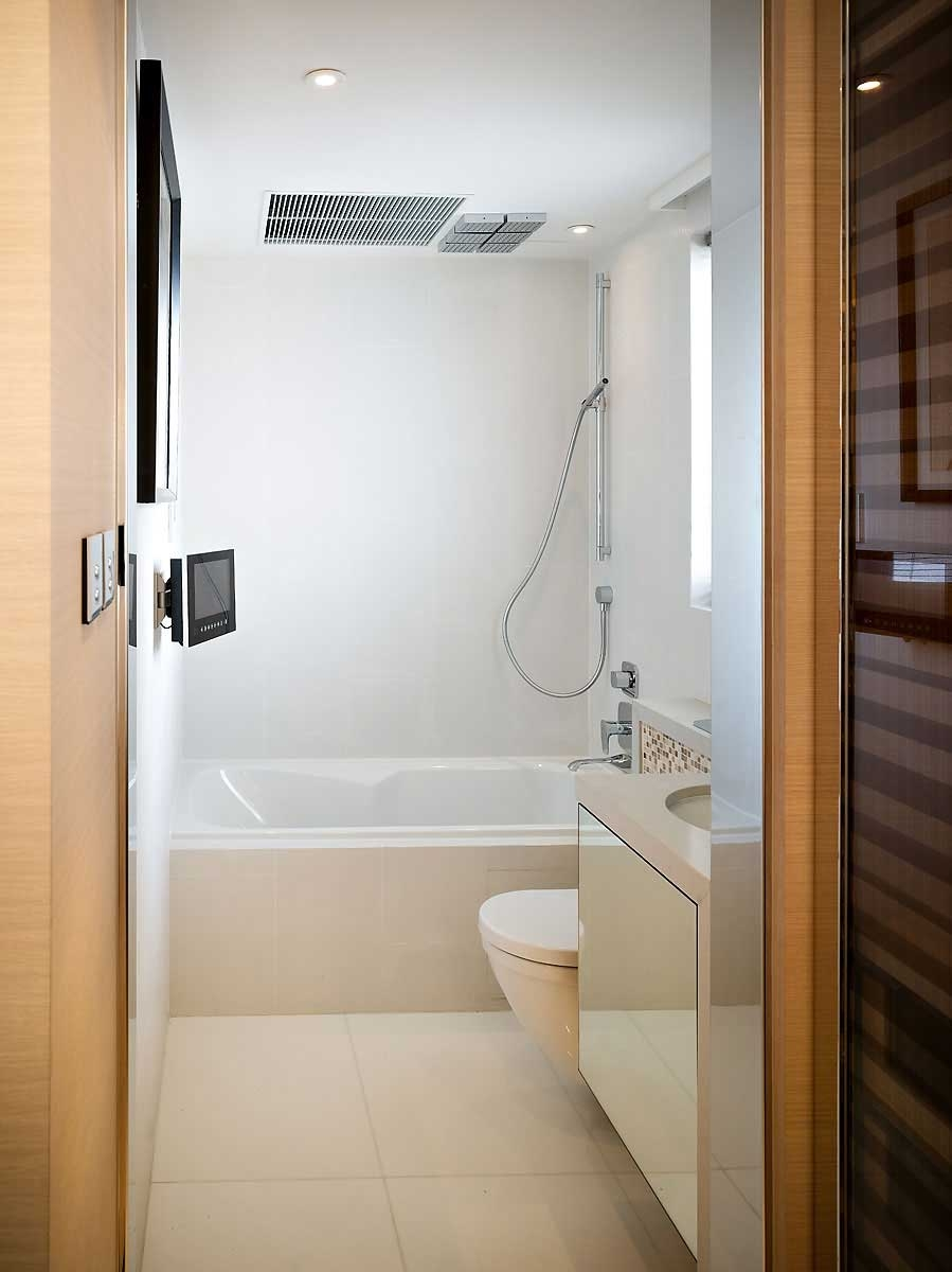 Choose Floating Vanity and wide Sink for Small Bathroom Design with White Bathtub and Open Shower Space