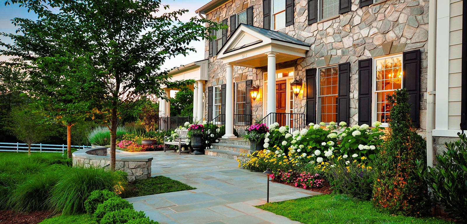 Choose Lovely Flowers and Green Plantations facing Stone Pathway and Grass Space for Front Yard Ideas