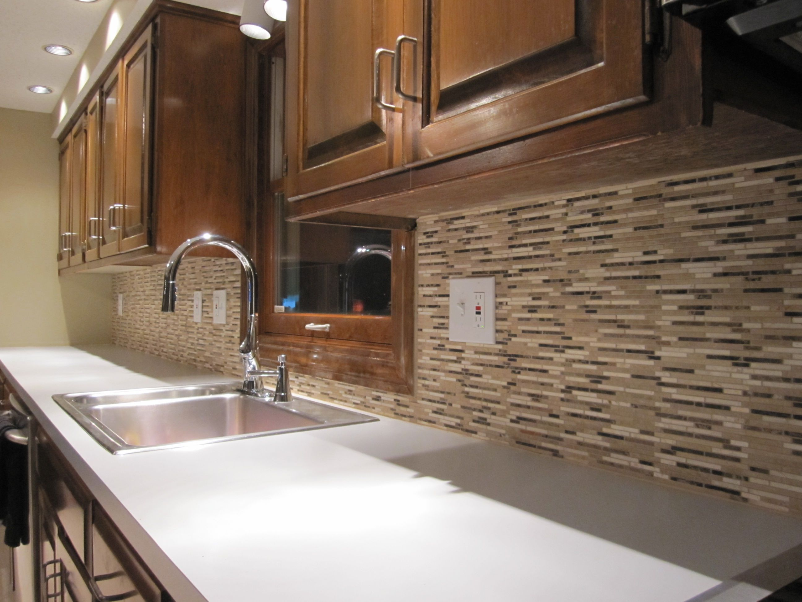 Choose Small Kitchen Tile Backsplash to Compelete Contemporary Kitchen with Oak Cabinets and White Countertop