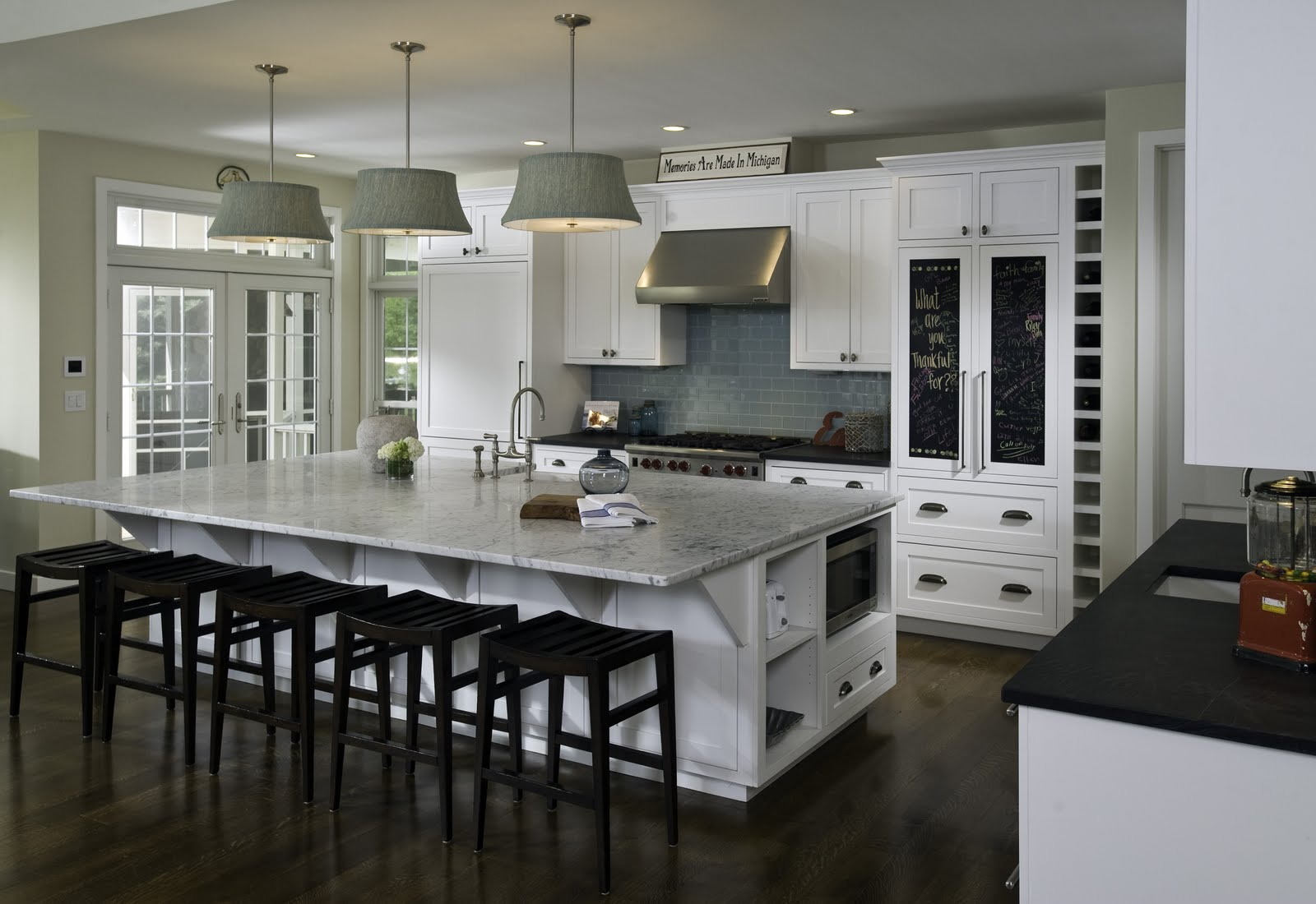 Choose White Kitchen Island with Dark Stools and Grey Marble Countertop under Grey Shaded Ceiling Lamps