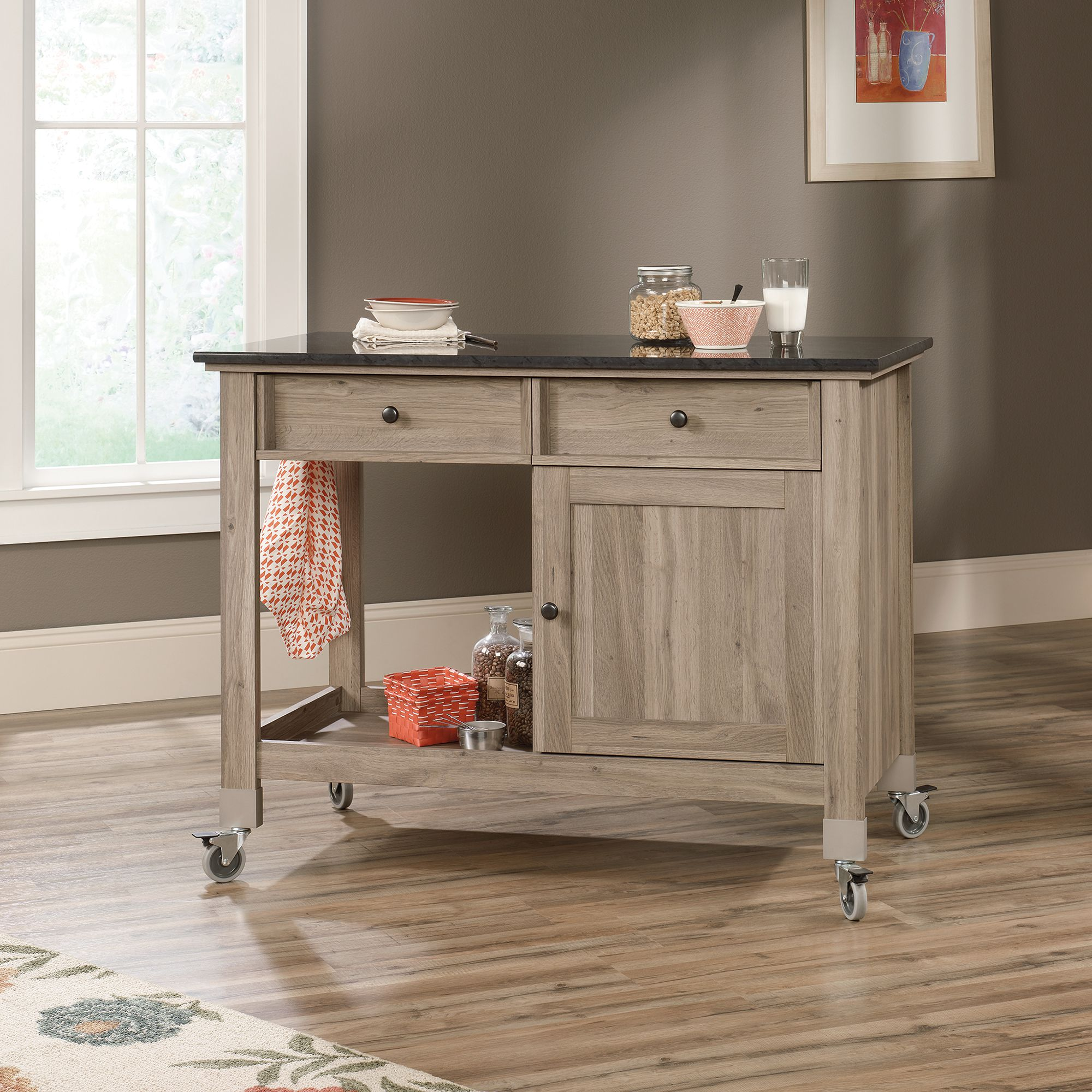 Choose this Classic Rolling Kitchen Island with Dark Top and Wooden Cabinets on Tiny Wheels