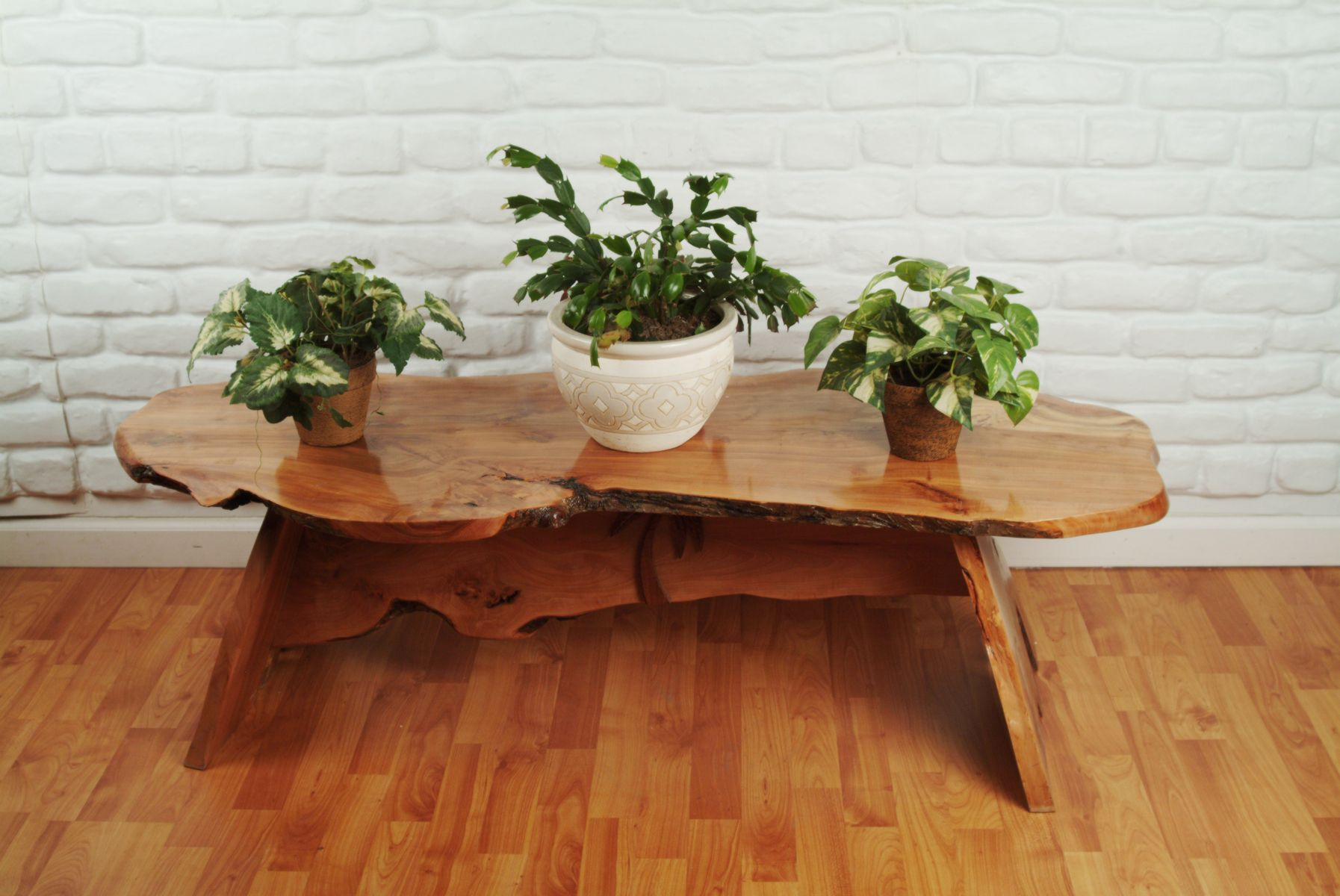 Choose this Unique Coffee Tables with Log Like Surface and Unusual Design on Hardwood Flooring