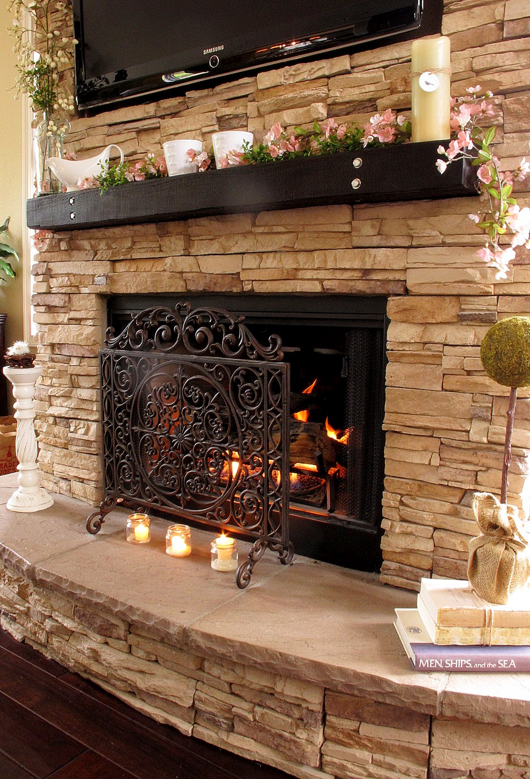 Classic Metal Cover for Awesome Stacked Stone Fireplace in Old Fashioned Living Room with Dark Hardwood Flooring