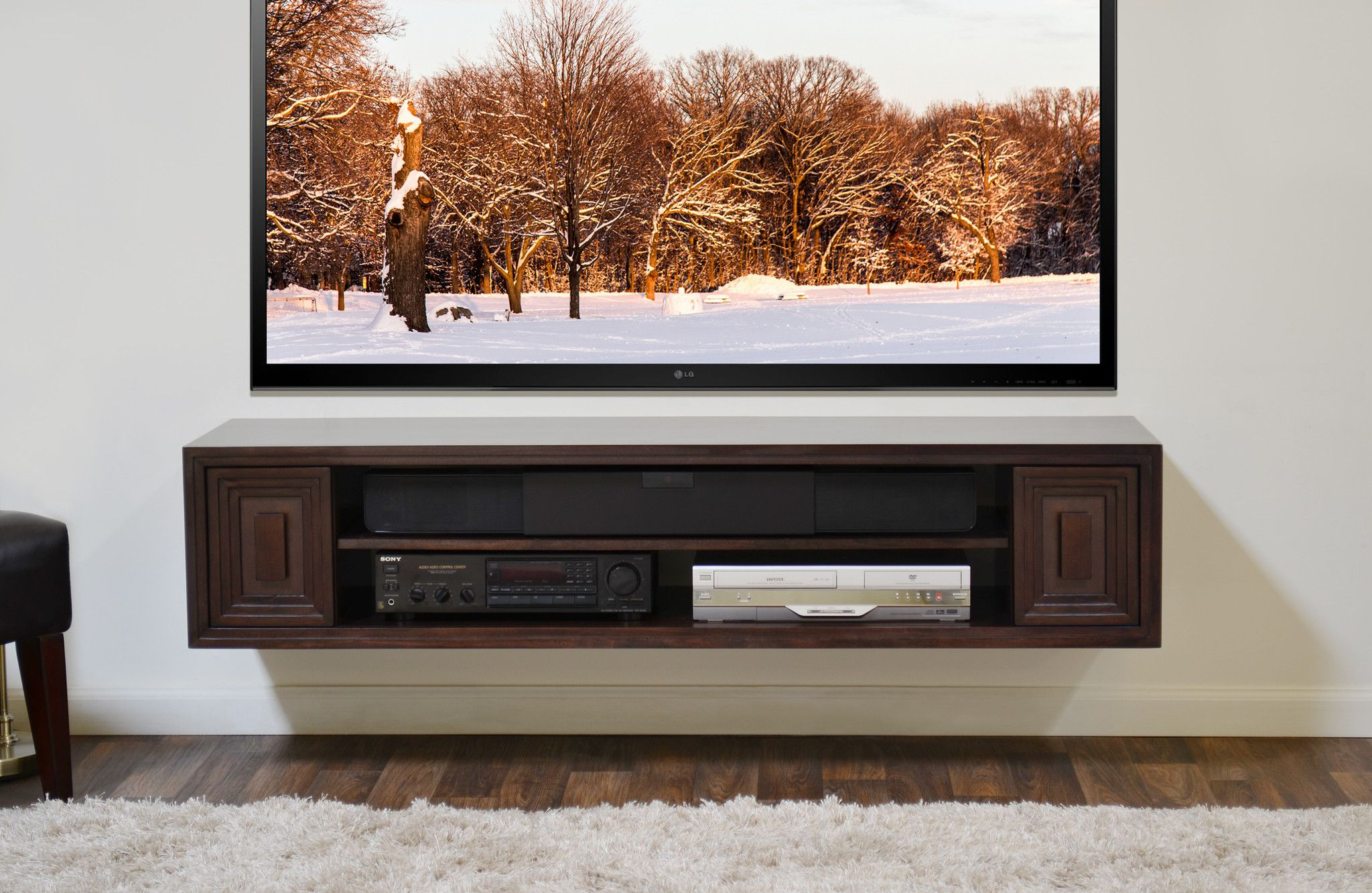 Classic Wall Mount TV Stand on White Painted Wall Completing Interesting Media Room with Oak Flooring