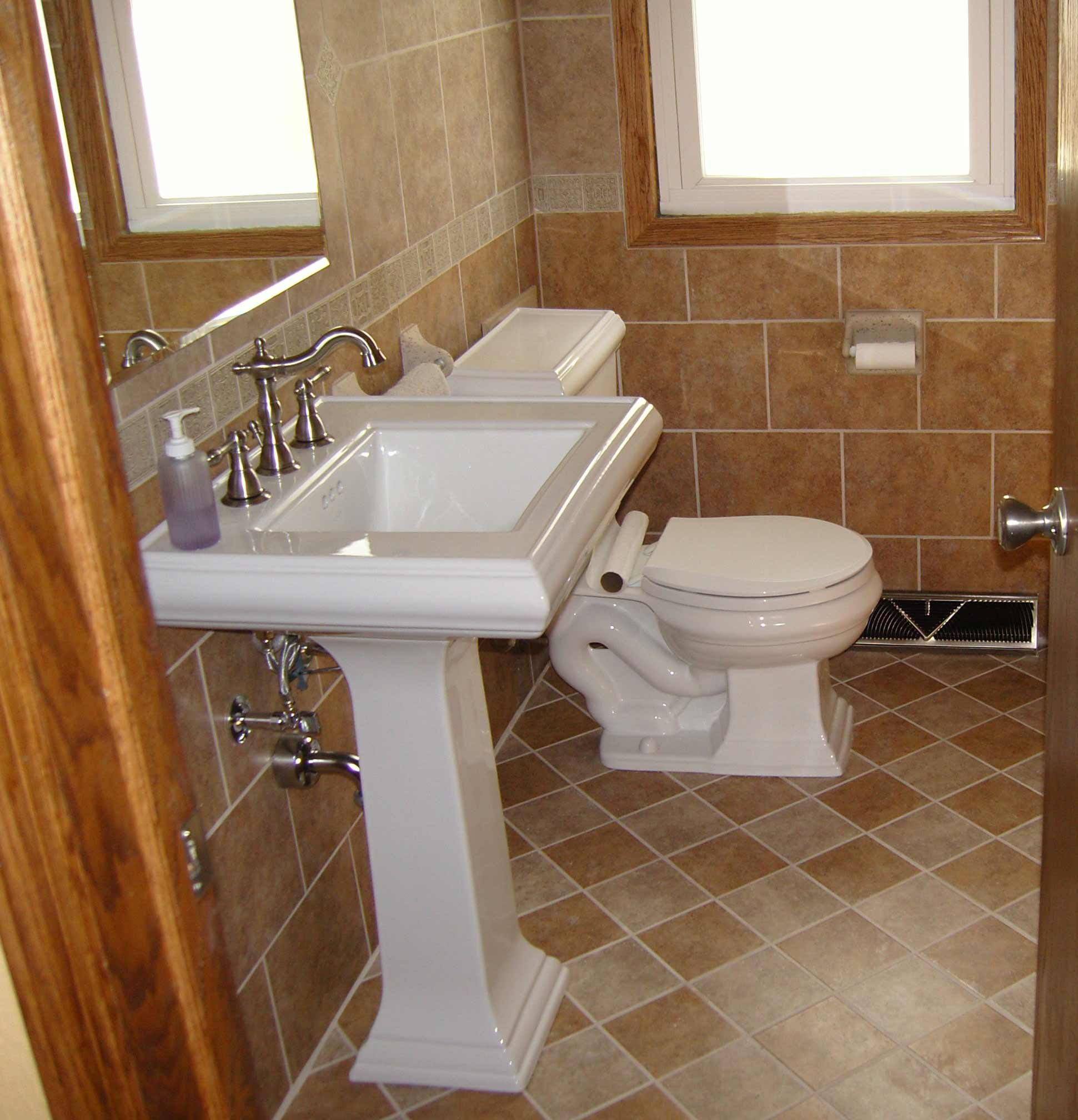 Classic White Pedestal Sink and Silver Faucet Used in Small Bathroom with Cream Bathroom Wall Tile