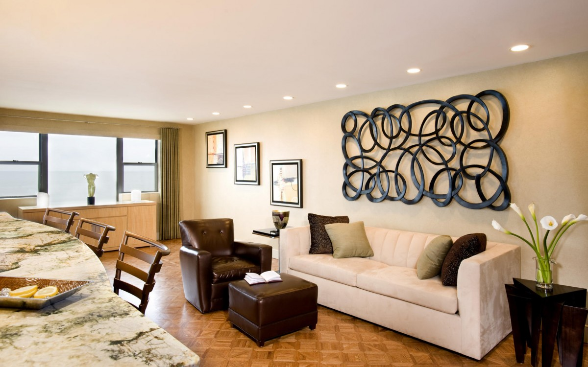 Clean White Sofa and Dark Side Table Completing Cozy Family Room with Unusual Wall Art Ideas