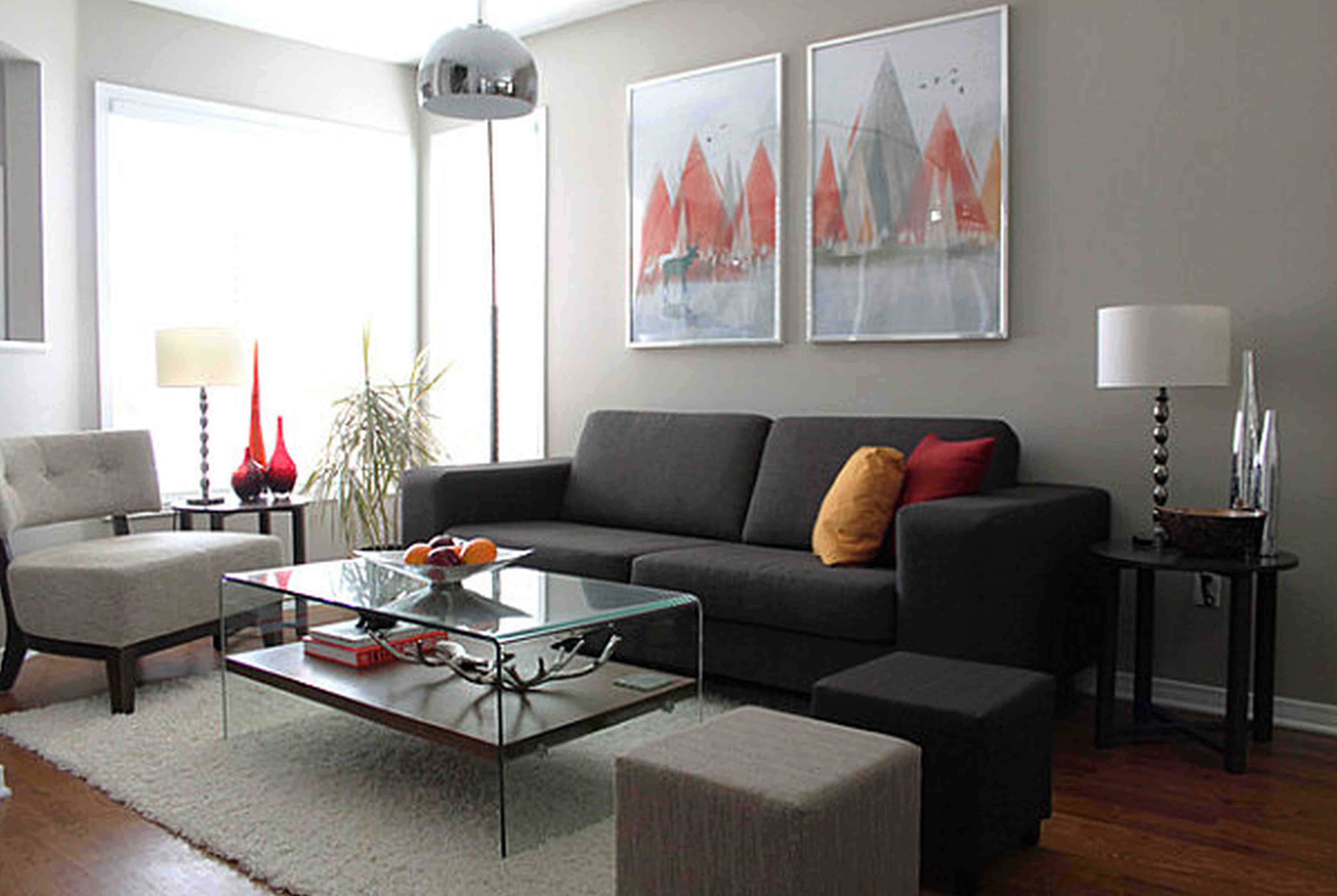 Clear Glass Top Coffee Table for Contemporary Living Room Furniture Ideas with Dark Sofa on Oak Flooring