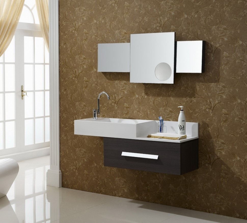 Clear Wall Mirrors Above Wide Sink And Small Floating Bathroom Vanity On Brown Flowery Wallpaper
