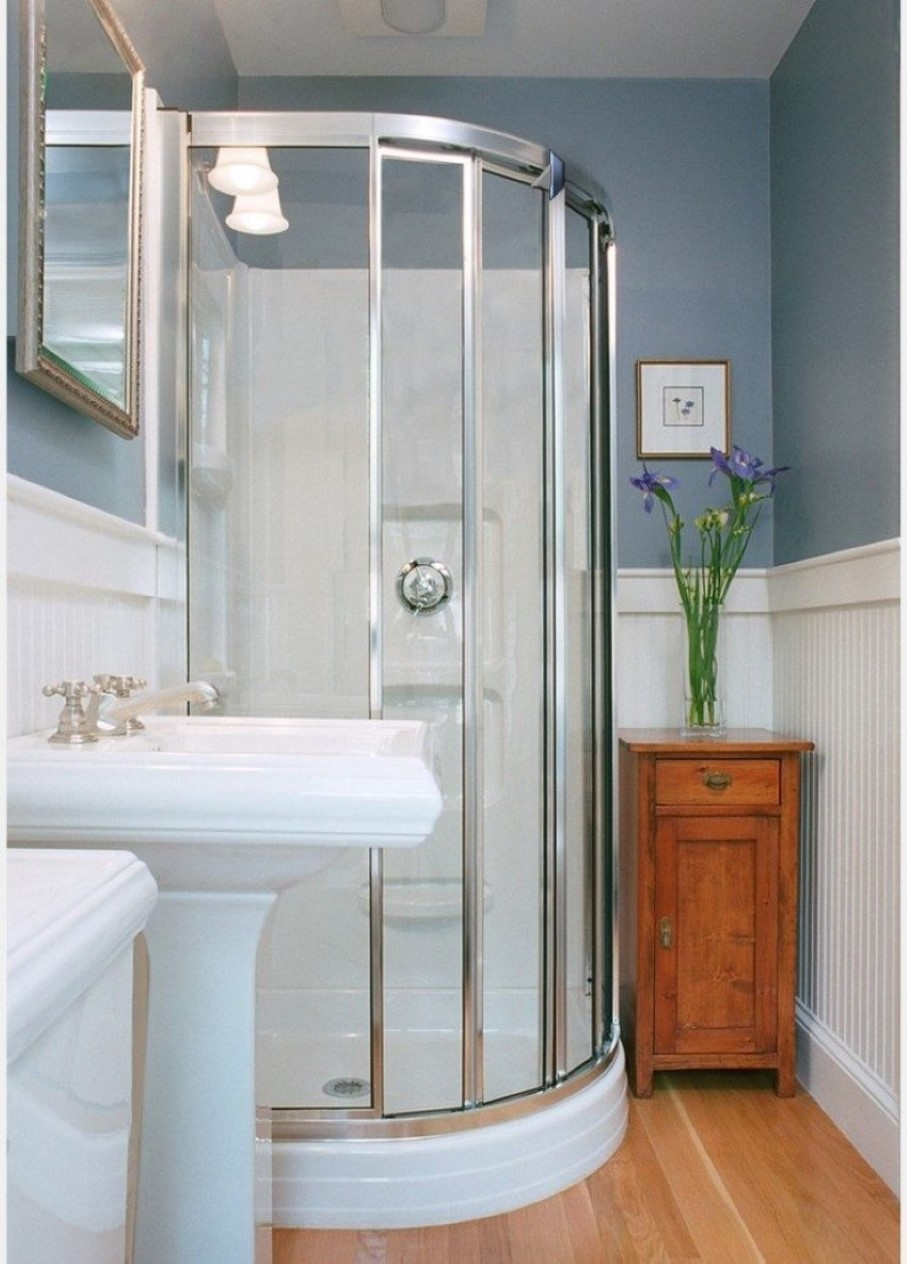 Closed Glass Walk In Shower and Traditional Pedestal Sink Storage on Laminate Hardwood Flooring