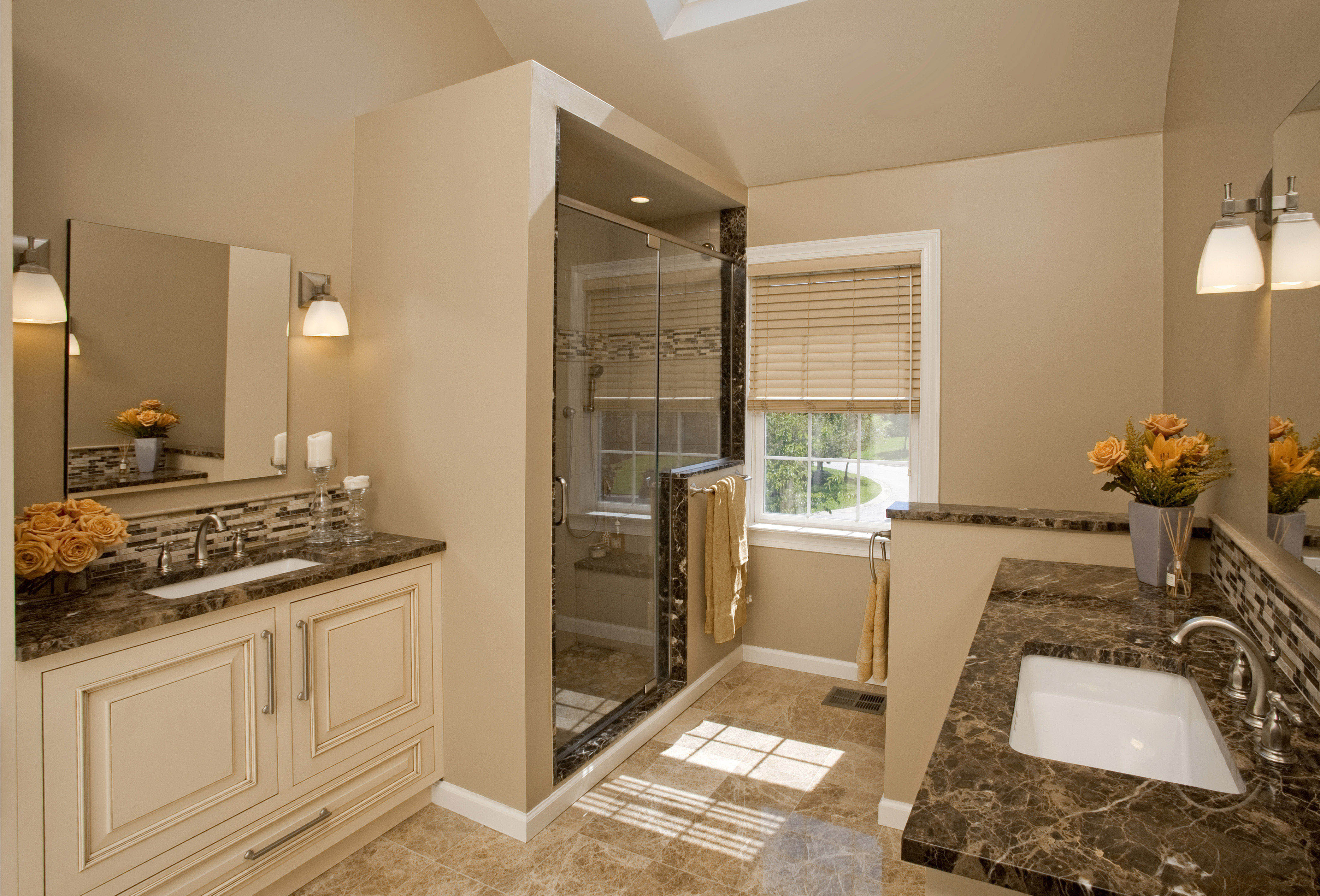 Closed Shower Room inside Traditional Bathroom with White Vanities and Small Side Table near Window