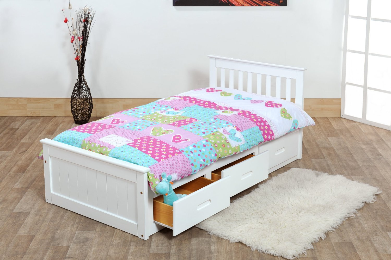 Colorful Duvet and White Kids Beds with Storage Placed in Wide Bedroom with Carpet Rug on Oak Flooring