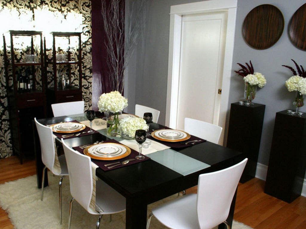 Combine Black Dining Table Centerpieces and White Chairs in Small Room with White Decorative Flowers
