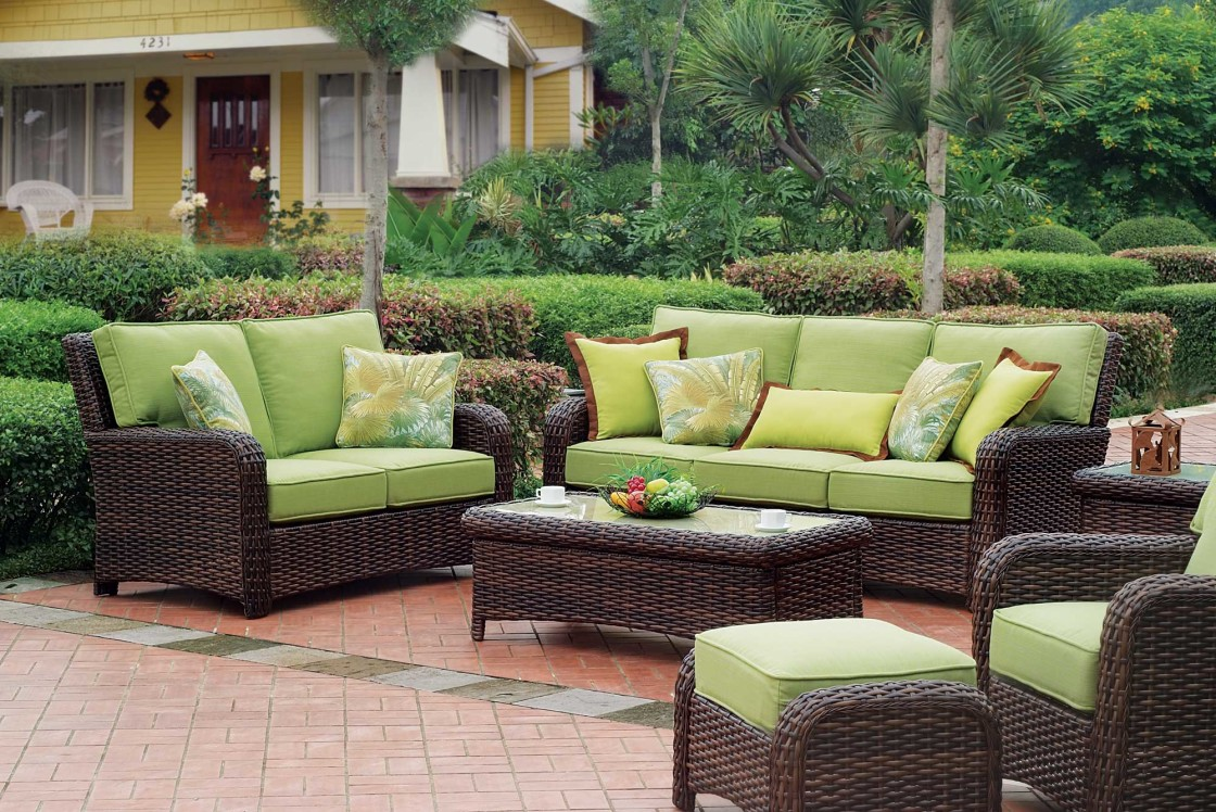 Combine Green Lather Seats and Wicker Sofas as Modern Patio Furniture with Wicker Table on Brick Flooring