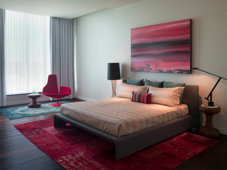 Combine Grey Bed and Red Carpet for Unique Bedroom Design Ideas with Red Chair and Round Side Table