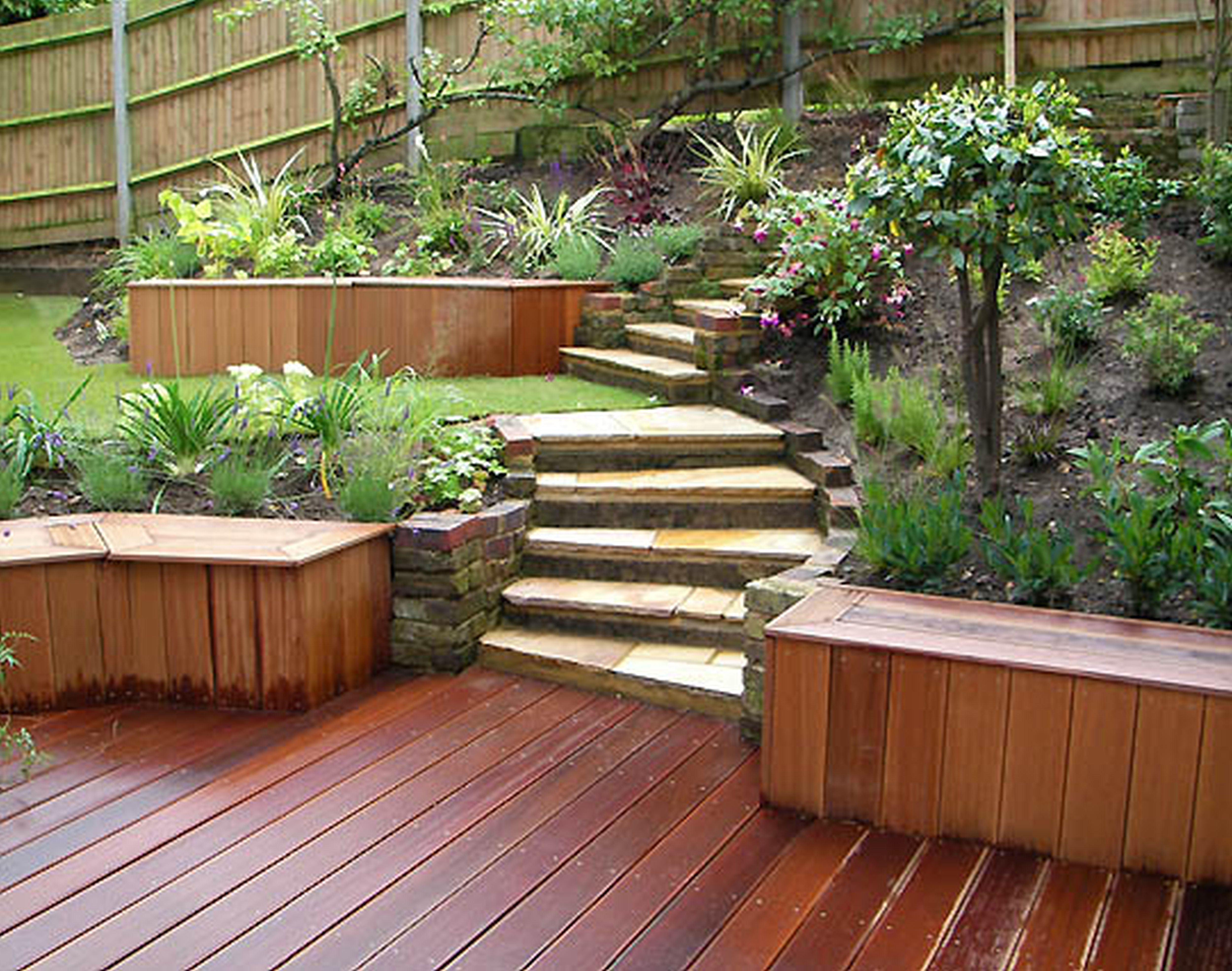 Combine Wavy Stone Stairs and Wooden Deck in Contemporary Flower Garden Ideas with Long Oak Benches