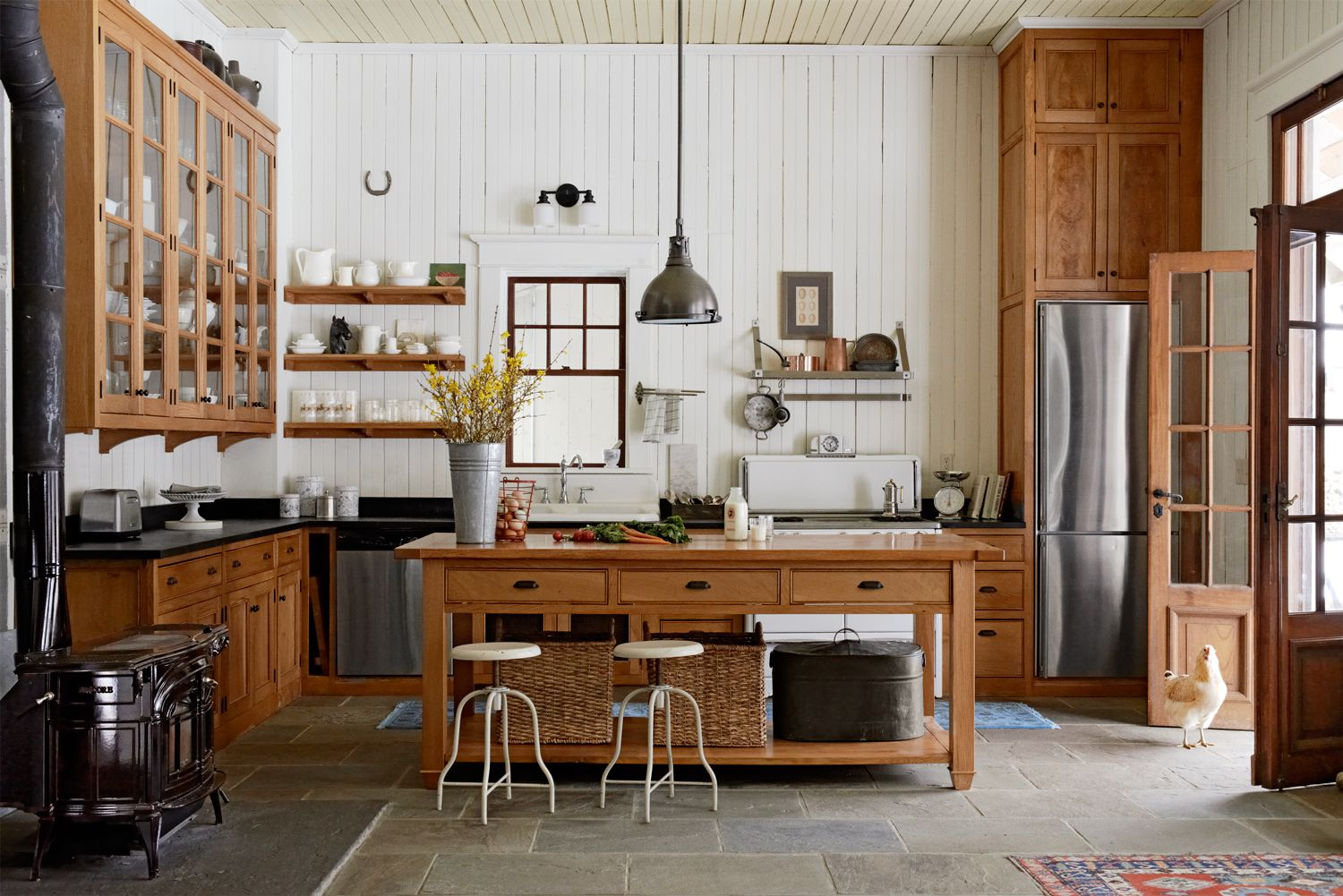 Combine Wooden Island and Round Metal Stools inside Old Fashioned Kitchen Decor Ideas with White Backsplash