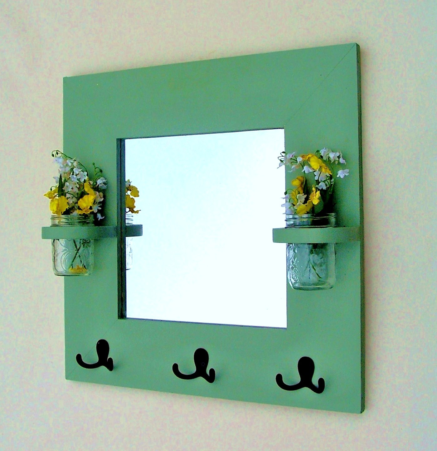 Complete Lovely Decorative Wall Hooks with Small Fake Flowers and Clear Wall Mirror