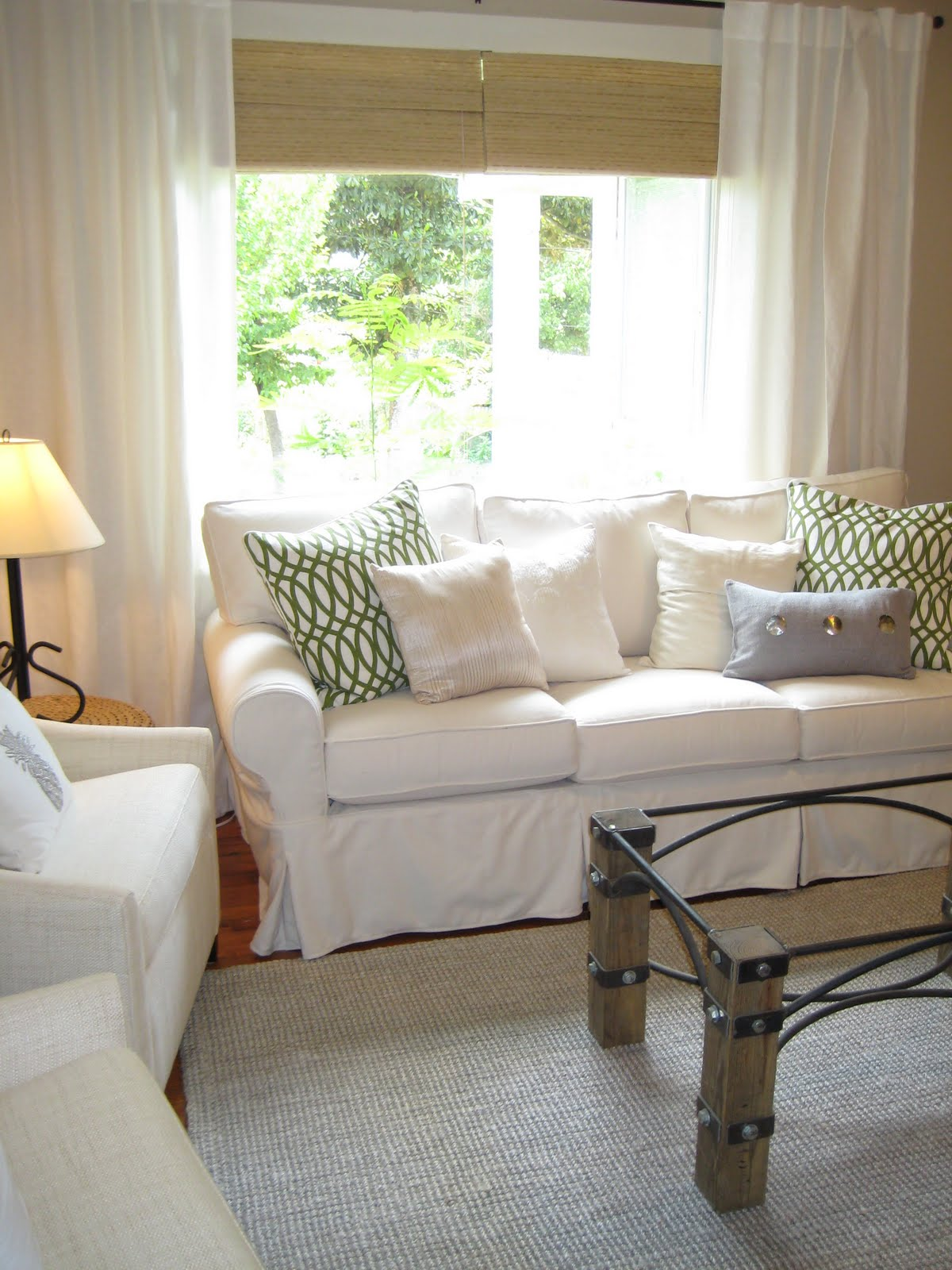 Pottery Barn Sofa Guide and Ideas MidCityEast : Complete Old Fashioned Living Room with White Pottery Barn Sofa and Rustic Table on Grey Carpet from midcityeast.com size 1200 x 1600 jpeg 237kB