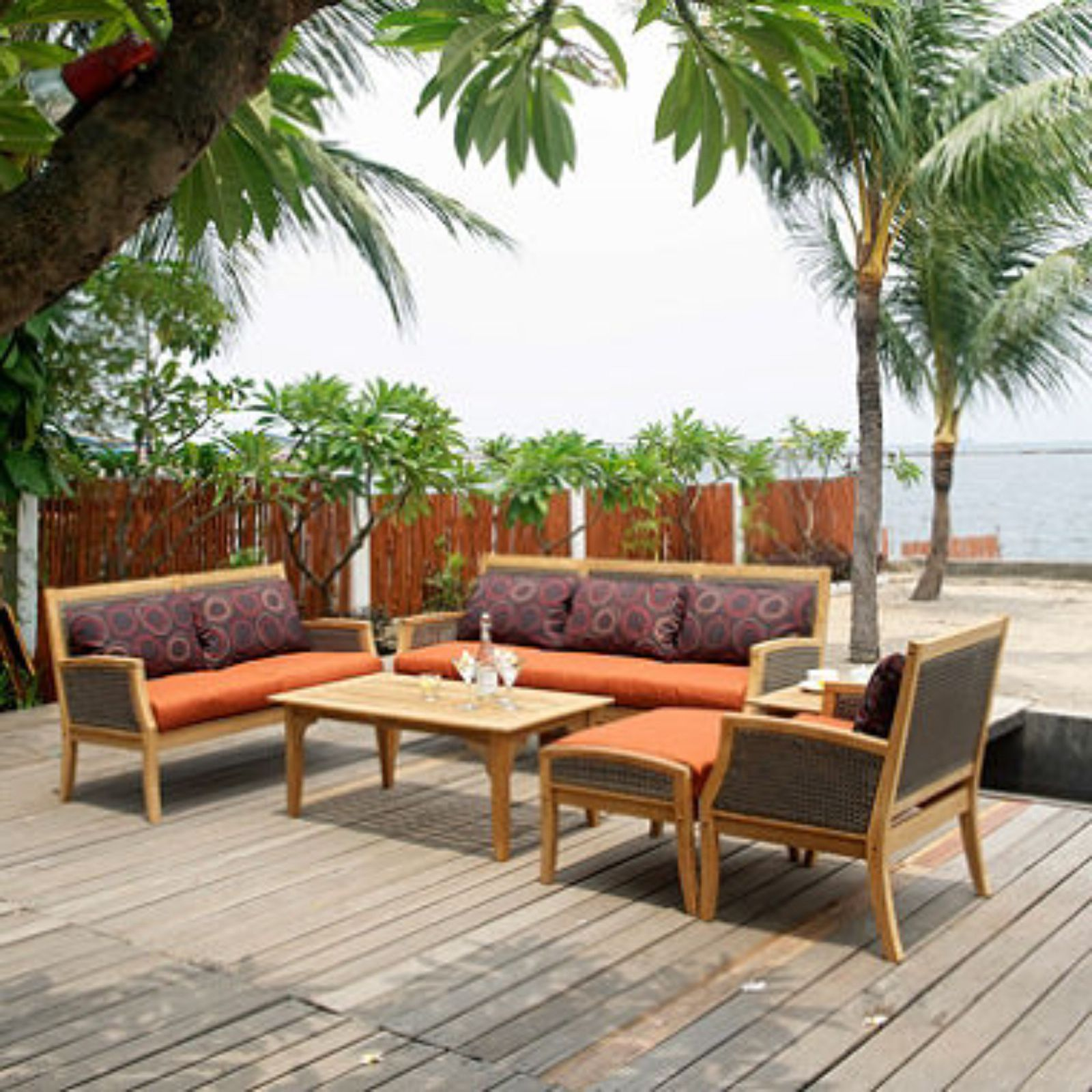 Complete Sea Side Patio with Wooden Sofas and Oak Coffee Table as Modern Patio Furniture on Wide Deck