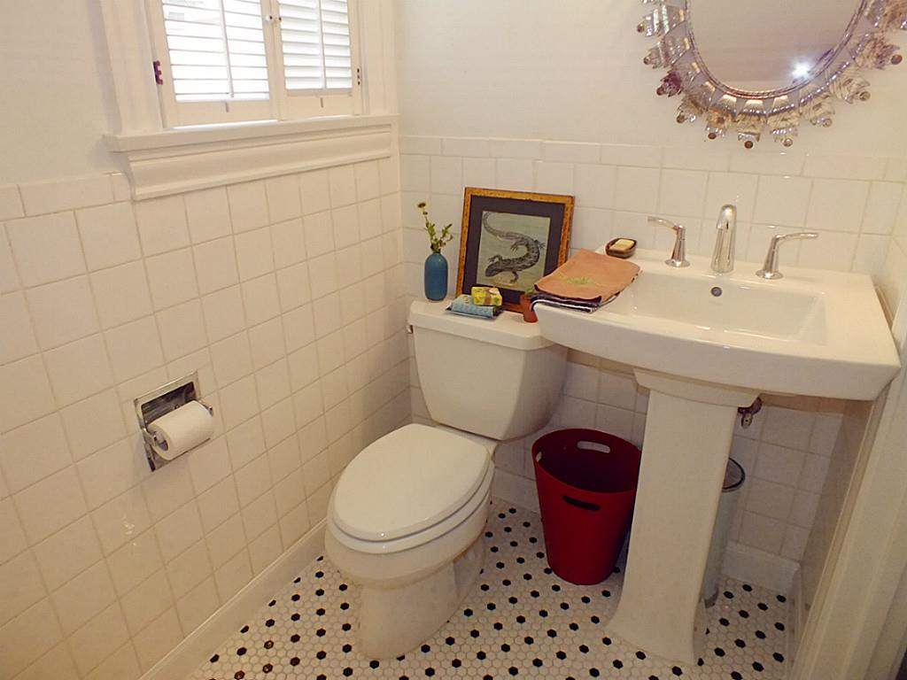 Complete Small Bathroom with Pedestal Sink Storage and Enchanting Wall Mirror on White Painted Wall