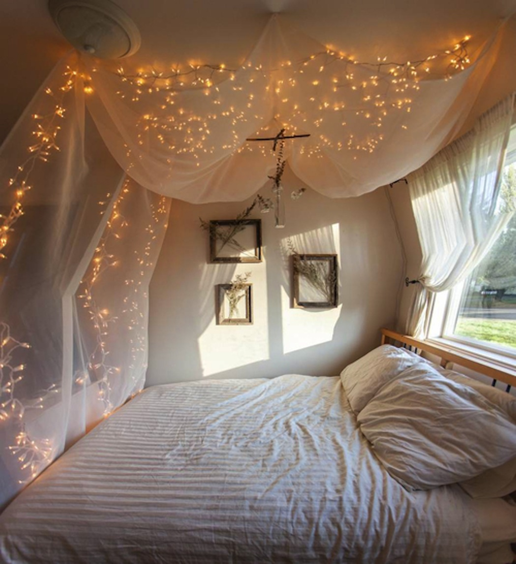 Complete Small Bedroom with White Girls Canopy Bed and Wonderful Light Ornaments under White Painted Ceiling