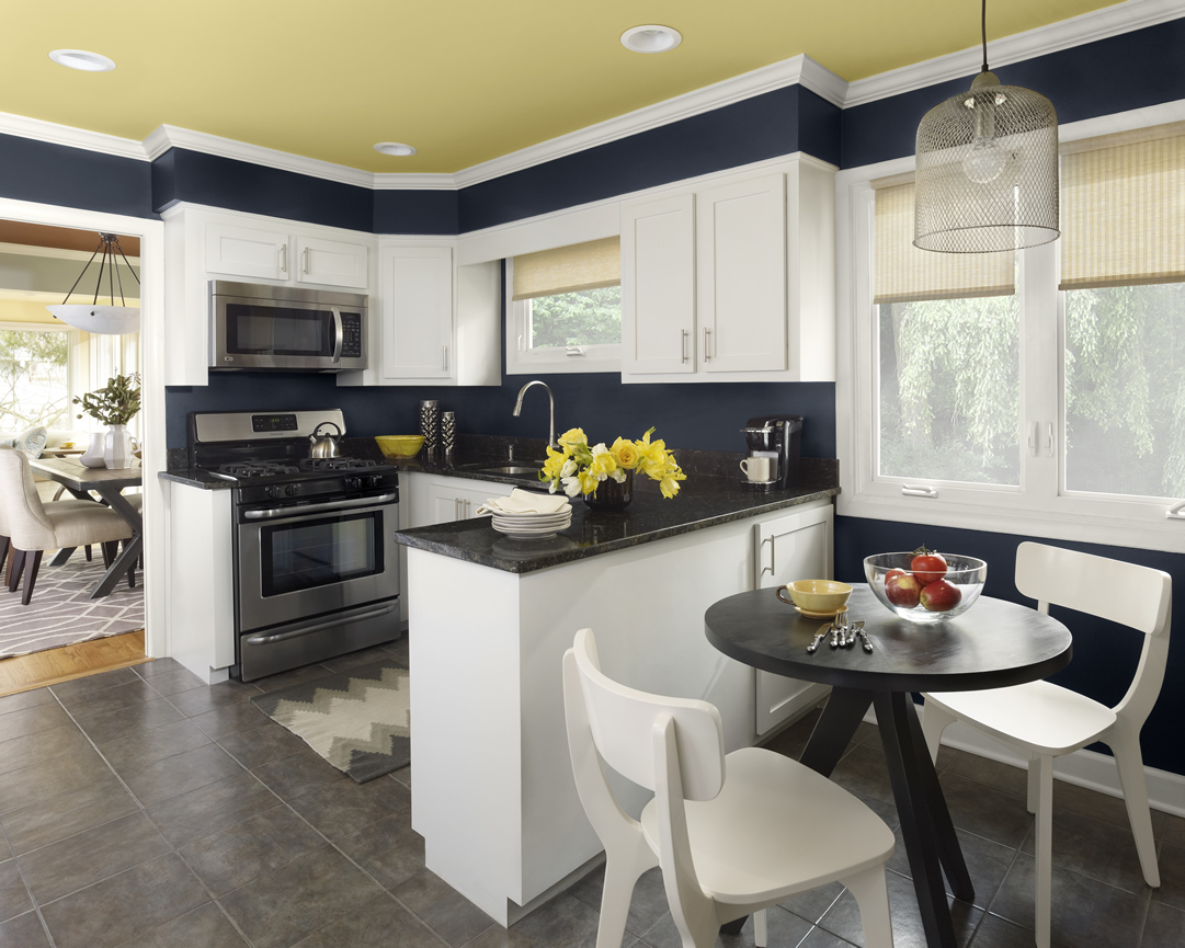 Complete Small Corner with Black and White Kitchen Color Ideas beside Round Black Breakfast Table and White Chairs