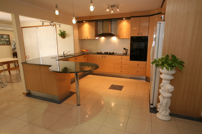 Complete Small Kitchen with White Kitchen Floor Tile and Wooden Counter under Small Ceiling Lamps