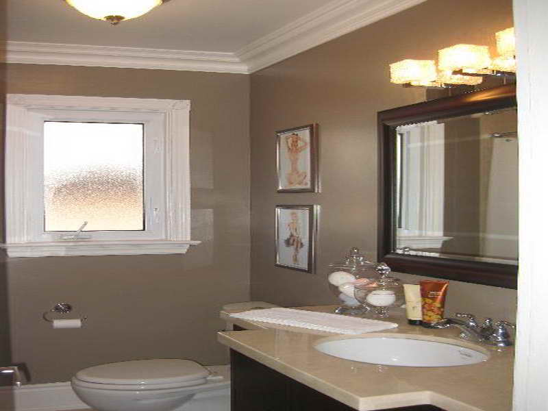 Attrayant Complete Small Space With Dark Vanity And White Sink Under Wood Framed  Mirror On Grey Bathroom