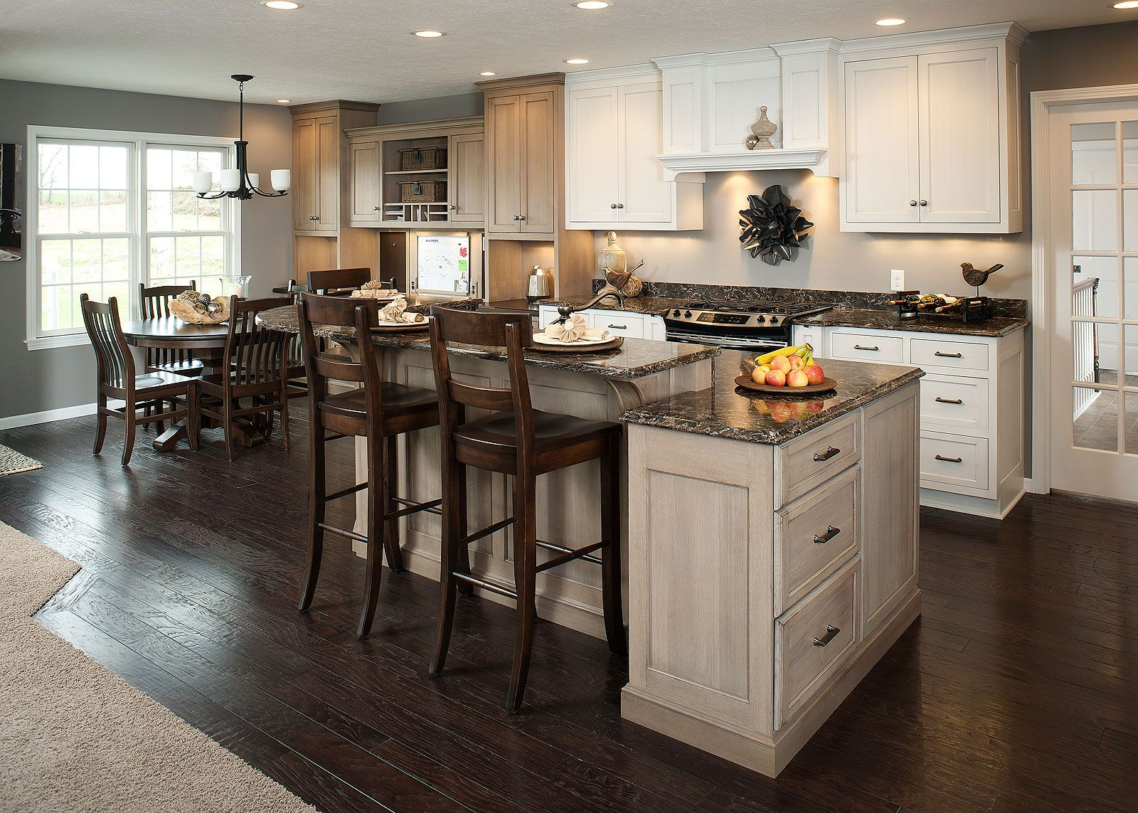 Complete Traditional Kitchen using Contemporary Kitchen Island with Rustic Oak Stools and Granite Countertop