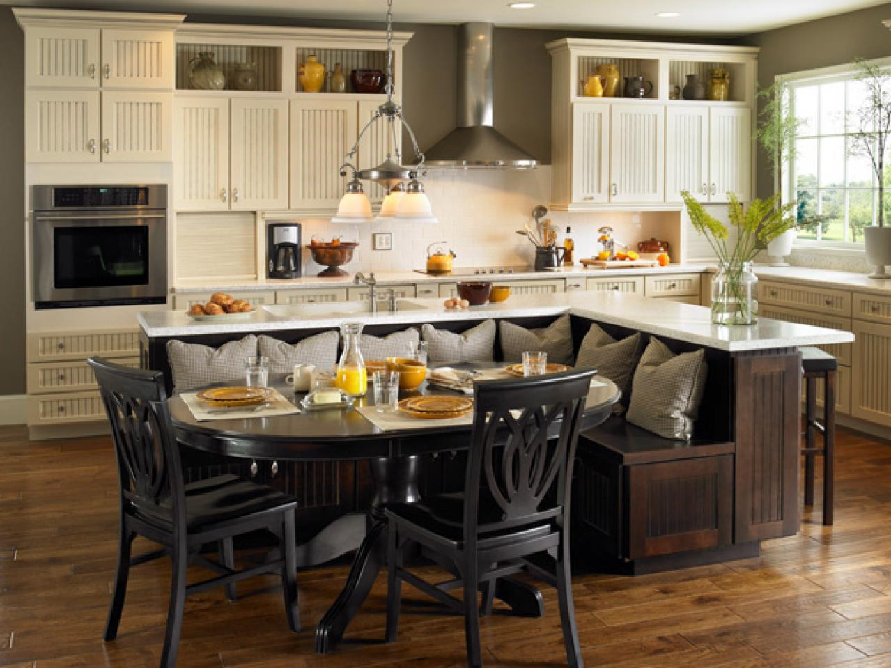 Complete Traditional Kitchen with Breakfast Nook and Oak Kitchen Islands with Seating on Hardwood Flooring