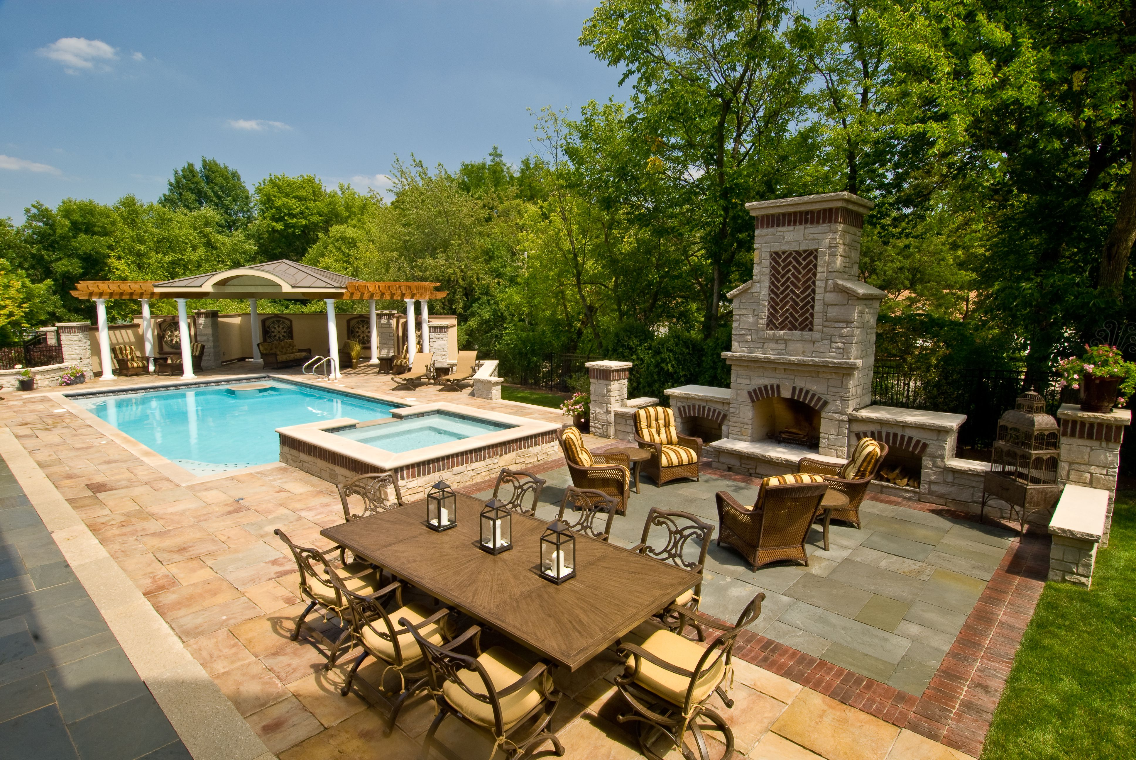 Complete Wide Backyard Landscaping Ideas with Outdoor Dining Table Set and Blue Swimming Pool