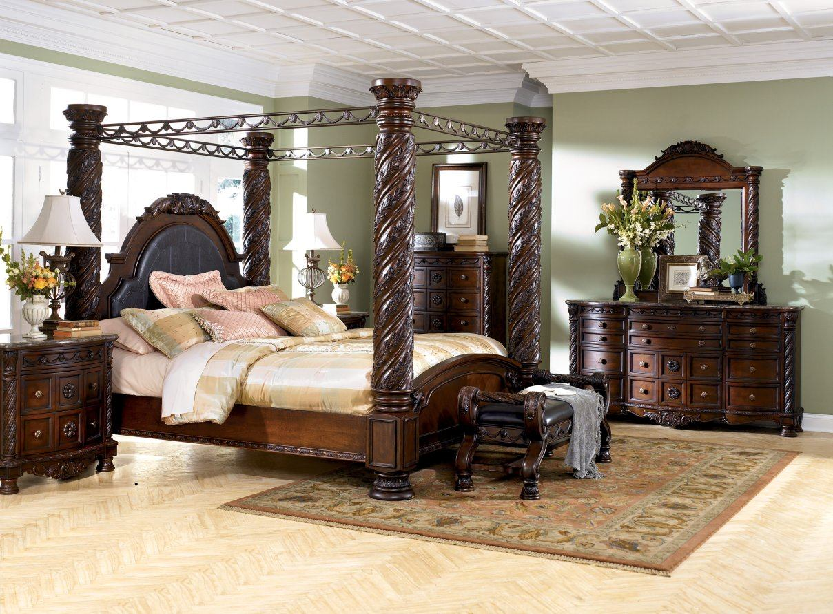 Complete Wide Bedroom with Classic Dressers and Oak King Canopy Bed near Gorgeous Bench