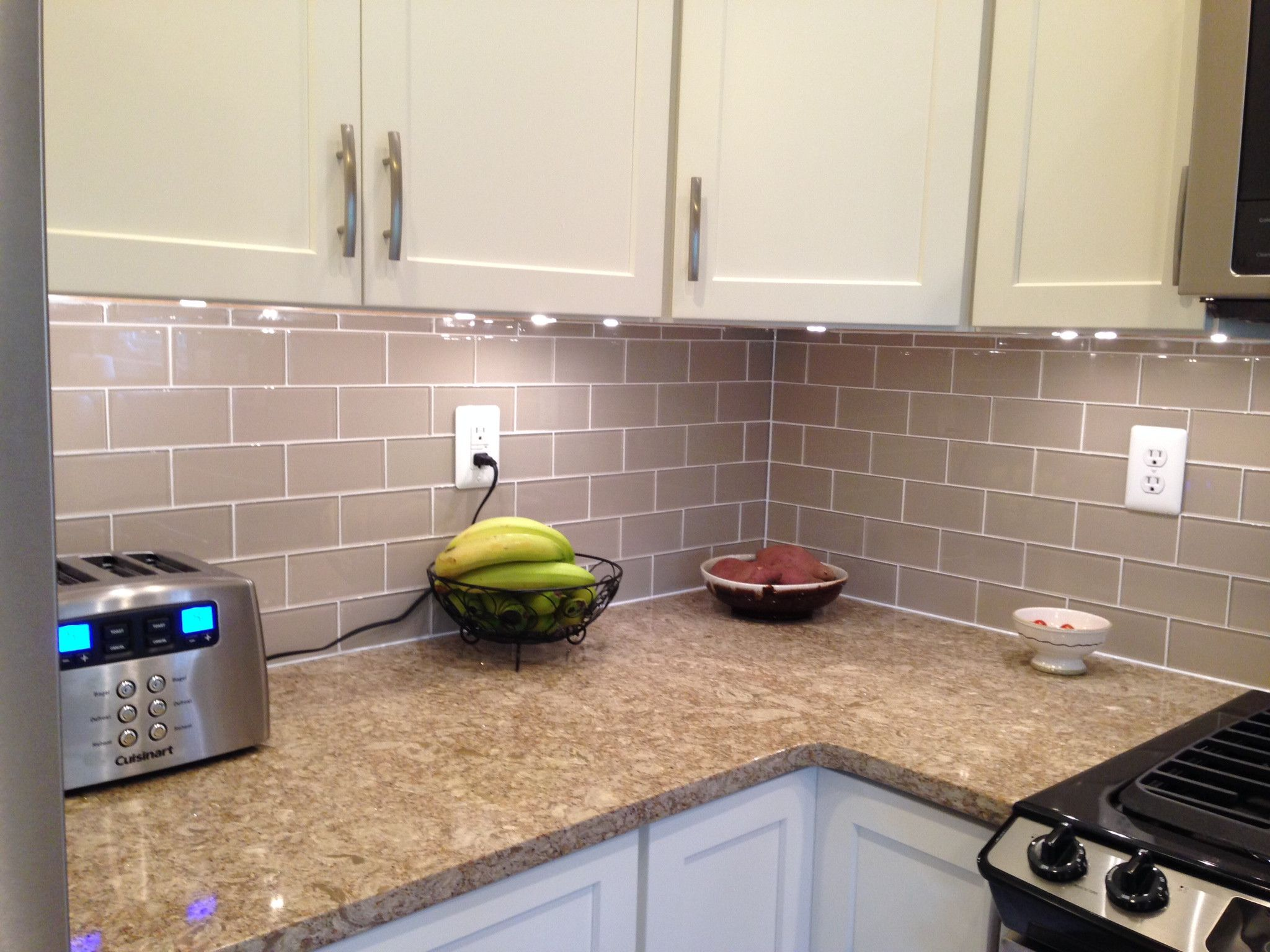 Tips on choosing the tile for your kitchen backsplash Glass subway tile backsplash