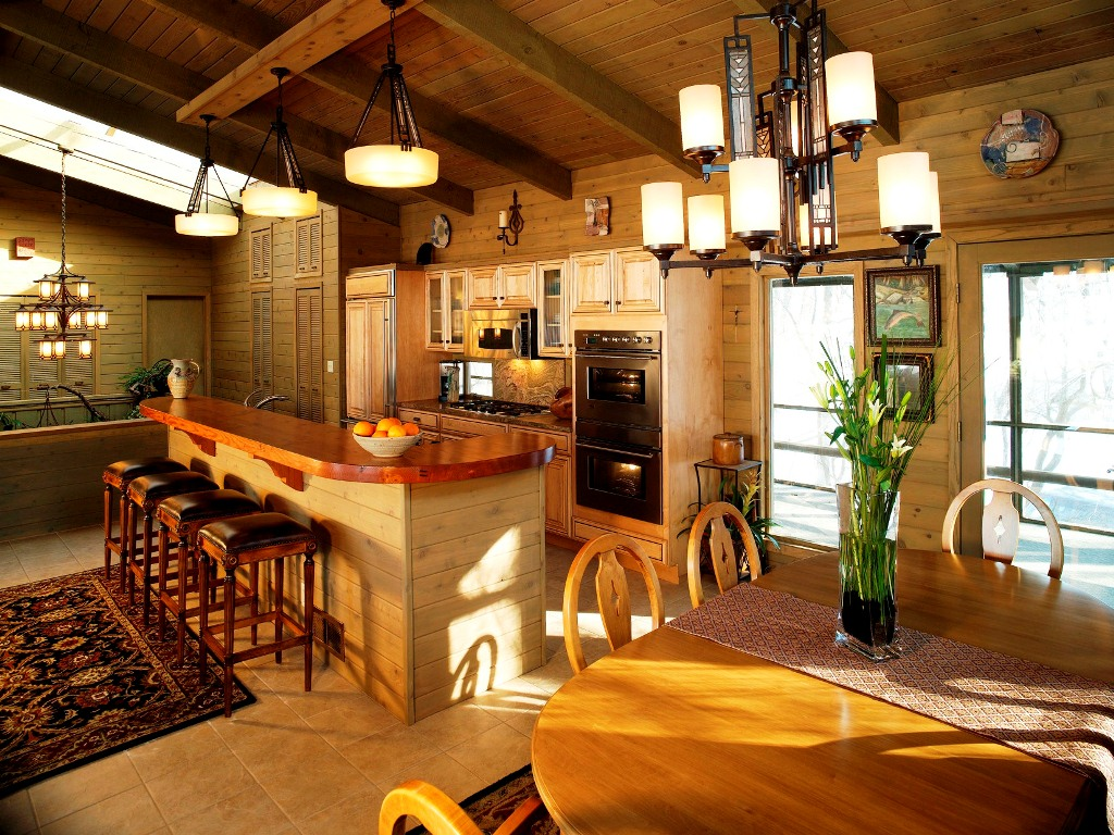 Complete your Kitchen using Country Decorating Ideas with Wooden Island and Square Stools under Classic Ceiling Lamps