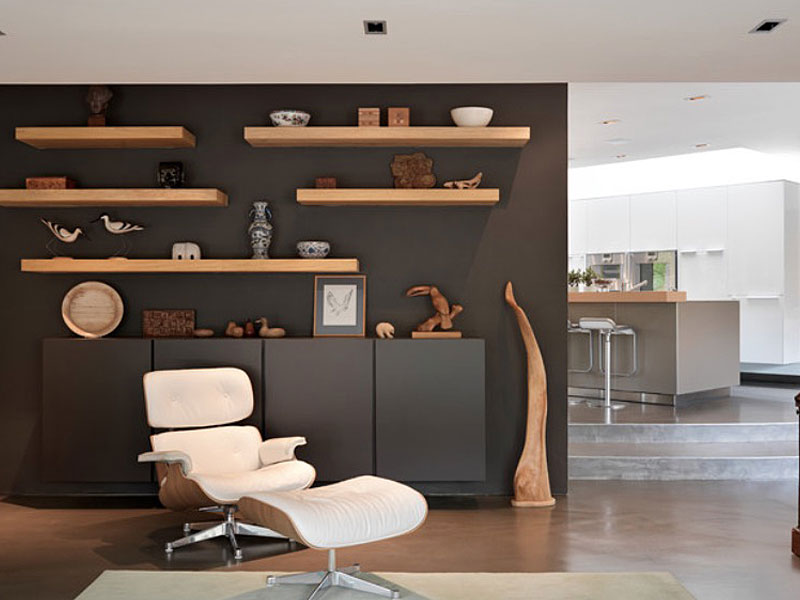 Cozy Chair And Food Rest In Appealing Family Room With Natural Wooden  Floating Wall Shelves
