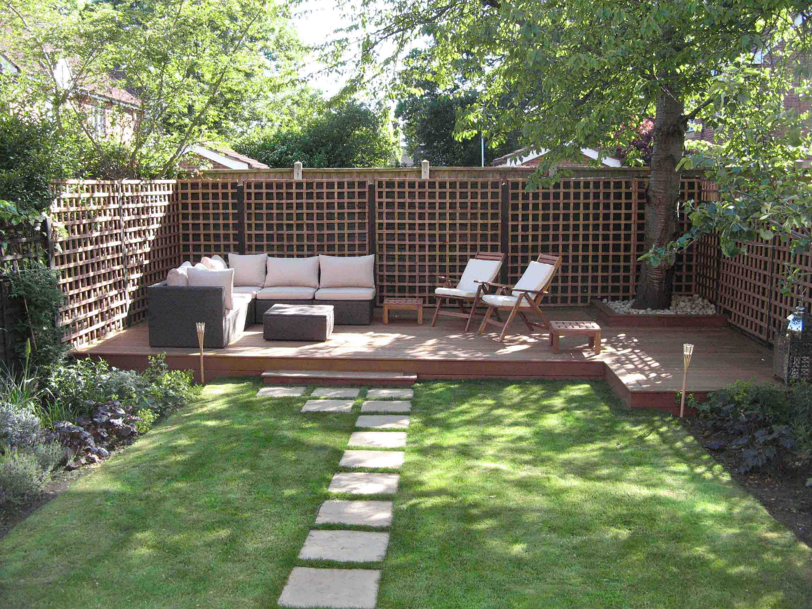 Cozy Wicker Sectional Sofa and Oak Chairs Placed on Wooden Deck in Small Garden Ideas