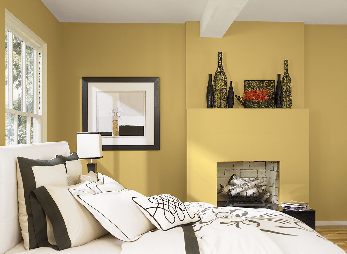 Cream Bedroom Color Ideas for Old Fashioned Room with White Bed and Comfy Bedding near Small Fireplace