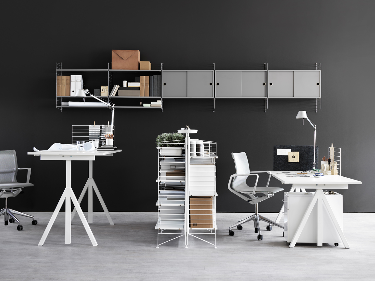 Dark Painted Wall for Modern Office with White Height Adjustable Desk and Grey Wall Cabinets