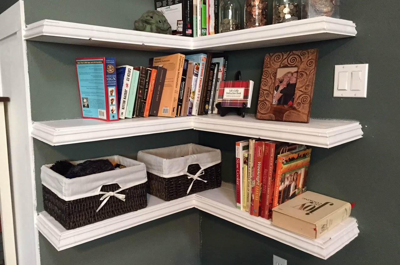 Decorate Classic White Floating Corner Shelves with Wicker Boes and Colorful Books on Grey Wall