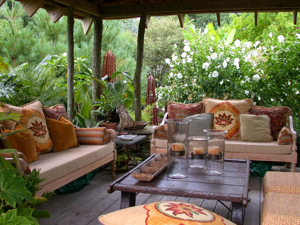 Decorate Comfy Patio with Candles on Rustic Large Square Coffee Table near Comfy Sofas on Wooden Deck