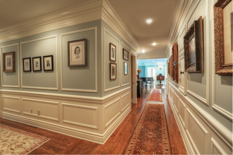 Decorate Hallway Using Classic Crown Molding Ideas With Vintage Wood Framed  Photos On Grey Painted Wall