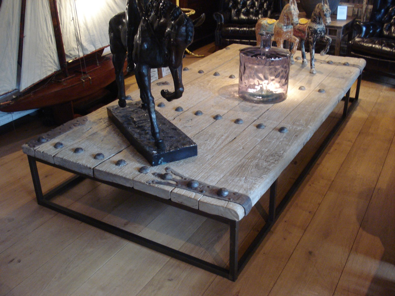 Decorate Old Fashioned Large Coffee Table with Glass Vase and Horse Sculptures on Laminate Oak Flooring
