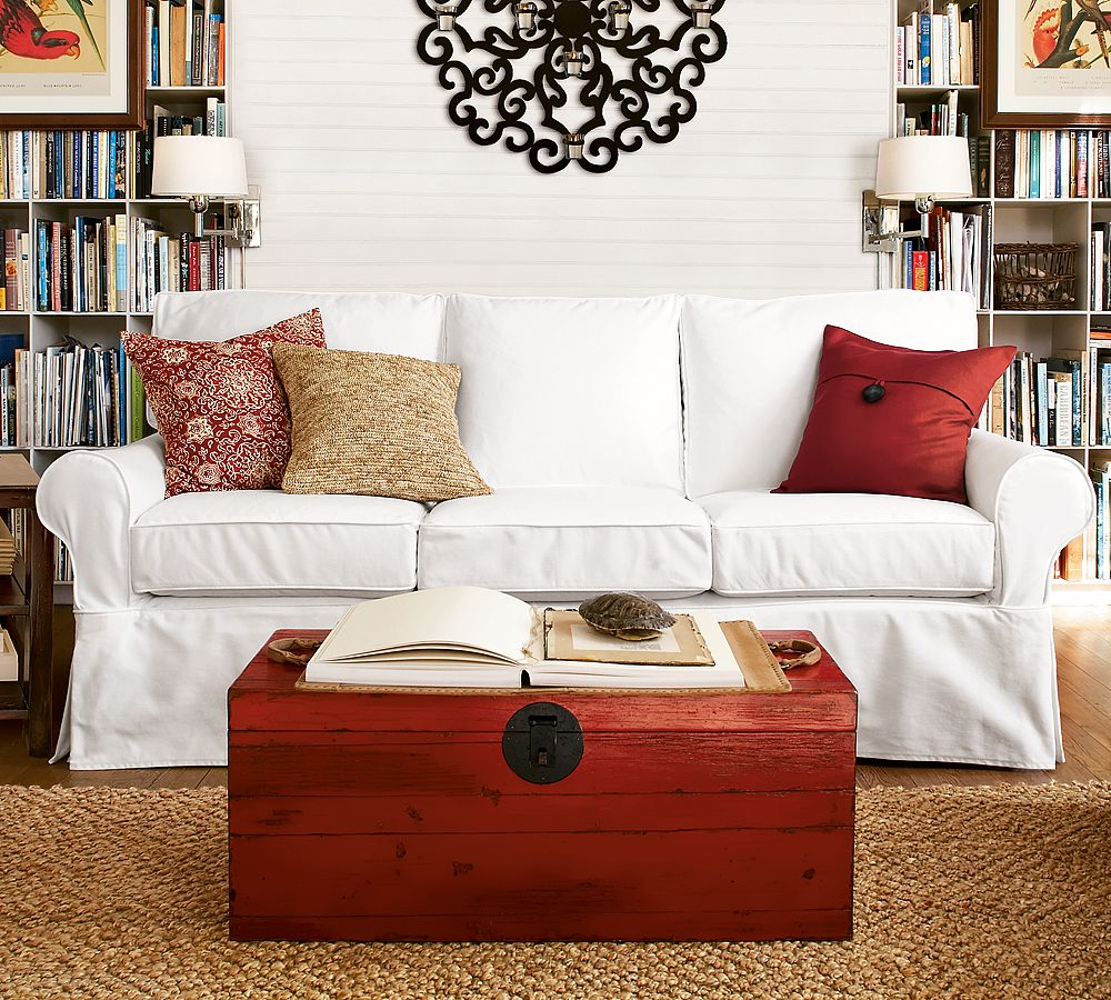 Decorate Sitting Room with Vintage Wall Art and White Pottery Barn Sofa facing Wooden Table