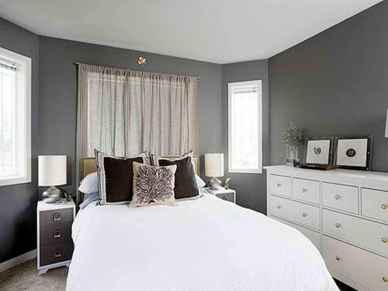 bedroom with white bed and classic dresser near grey paint colors