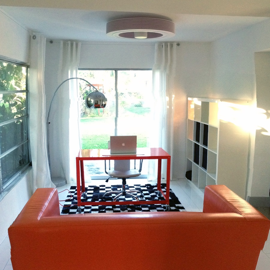 Decorate Stylish Home Office with Orange Table and Leather Sofa under Modern Bladeless Ceiling Fan